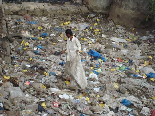 In Pune, India a man lives among the garbage heaps and spends his time picking through them looking for something valuable