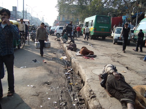 A street in Delhi, India, where people sleep on the streets without even a sheet